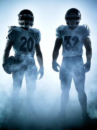 白い背景にシルエットの影で 1 つのアメリカン フットボール選手肖像 写真素材