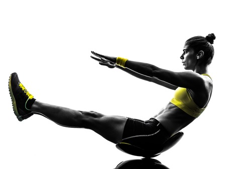abs: one caucasian woman exercising  crunches fitness in studio silhouette isolated on white background Stock Photo