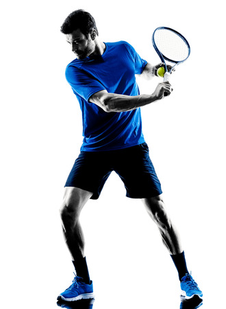 one caucasian man playing tennis player in studio silhouette isolated on white background 스톡 콘텐츠