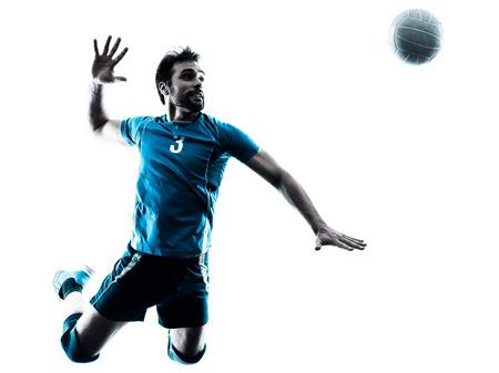 voleibol: un hombre cauc�sico de voleibol saltando en el estudio de silueta aislados sobre fondo blanco en el estudio de la silueta aislado en el fondo blanco Foto de archivo