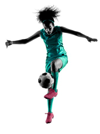 one teenager girl child  playing soccer player in silhouette isolated on white background Stock Photo