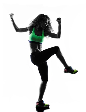 zumba: one african woman woman zumba dancer dancing exercises  in studio silhouette isolated on white background Stock Photo