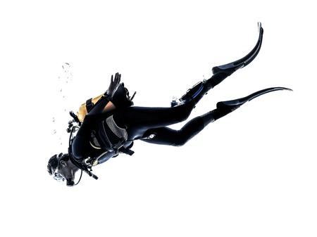 picada: un caucásico scuba hombre zambullida en la silueta del estudio aislada en el fondo blanco Foto de archivo