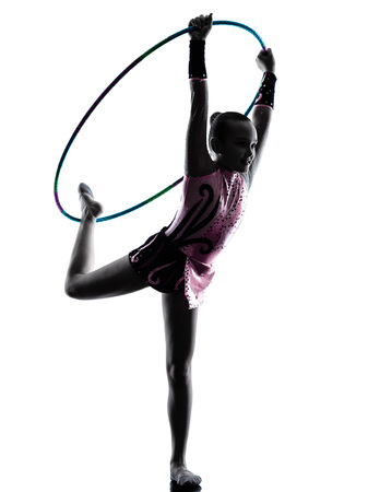 little one: one caucasian little girl child  exercising Rhythmic Gymnastics in silhouette isolated on white background