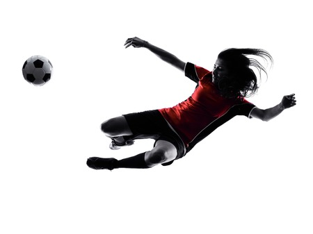 people in action: one woman playing soccer player in silhouette isolated on white background Stock Photo