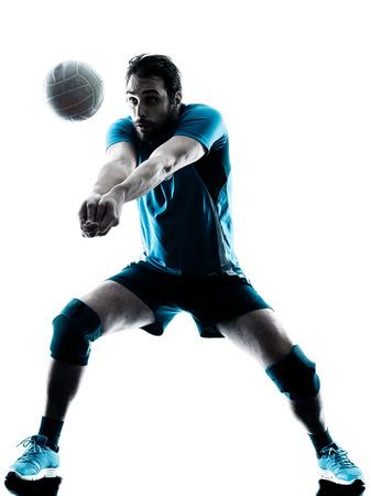 白い背景に分離されたスタジオ シルエットで 1 つの白人男性バレーボール 写真素材