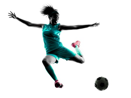 one teenager girl child  playing soccer player in silhouette isolated on white background 写真素材