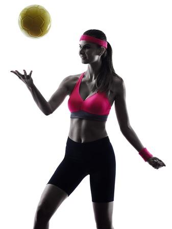 ballon volley: une femme joueur de beach volley silhouette en silhouette studio isol� sur fond blanc Banque d'images