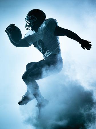 Un giocatore di football americano ritratto in silhouette ombra su sfondo bianco Archivio Fotografico - 44691346