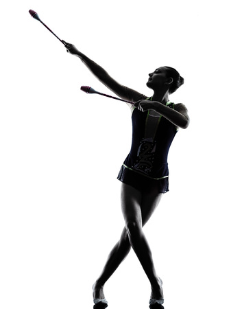 rhythmic gymnastics: one caucasian woman exercising Rhythmic Gymnastics in silhouette isolated on white background