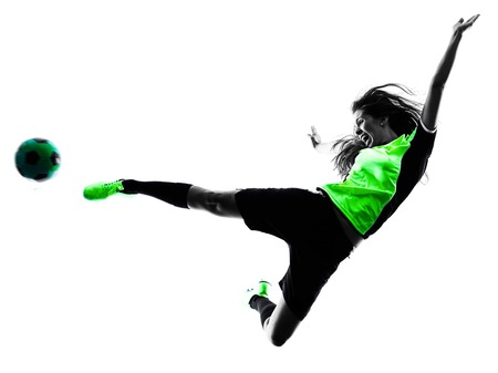women playing soccer: one woman playing soccer player in silhouette isolated on white background Stock Photo