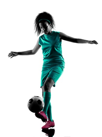 shadow silhouette: one teenager girl child  playing soccer player in silhouette isolated on white background Stock Photo
