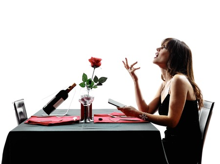 woman alone: one woman waiting dinning in silhouettes on white background
