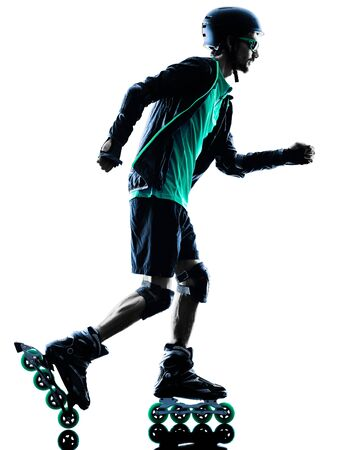 blading: one caucasian man Roller Skater inline  Roller Blading in silhouette isolated on white background