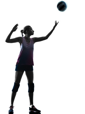 volleyball: one caucasian woman volleyball in studio silhouette isolated on white background