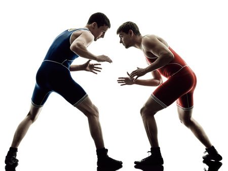 two caucasian wrestlers wrestling men on isolated silhouette white background Stockfoto