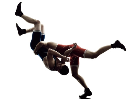 wrestlers: two caucasian wrestlers wrestling men on isolated silhouette white background Stock Photo
