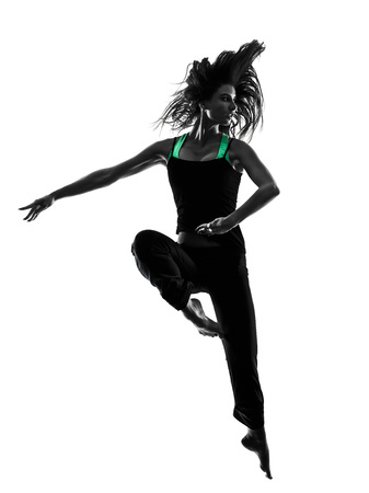 taniec: one woman dancer dancing in studio silhouette isolated on white background