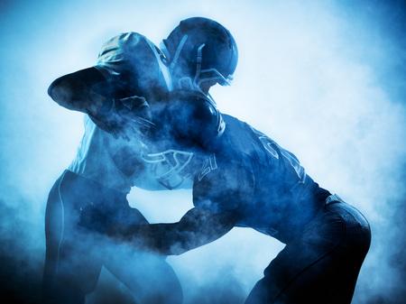 jugadores de futbol: un estadounidense retrato jugadores de f�tbol en silueta sombra sobre fondo blanco