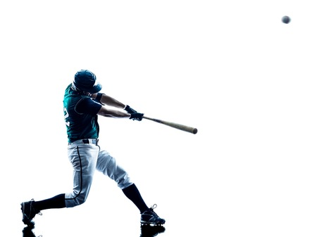 one caucasian man baseball player playing  in studio  silhouette isolated on white background Фото со стока