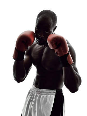 combative: one man boxers boxing on isolated silhouette white background Stock Photo