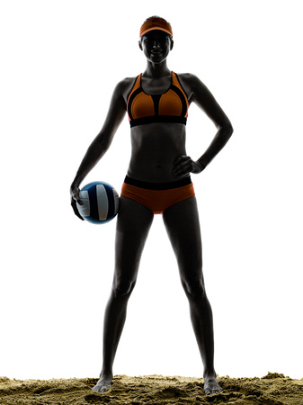 pelota de voley: one woman beach volley ball player silhouette in studio silhouette isolated on white background