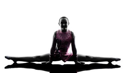 gymnastics: one caucasian woman teenager  and little girl child exercising Rhythmic Gymnastics in silhouette isolated on white background Stock Photo