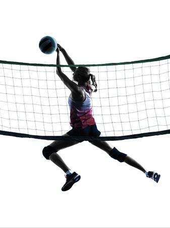 pelota de voleibol: un cauc�sico mujer de voleibol en el estudio de la silueta aislado en el fondo blanco