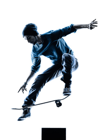 in action: one caucasian man skateboarder skateboarding  in silhouette isolated on white background