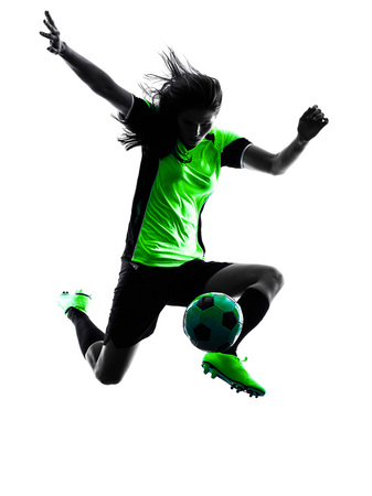 woman white background: one woman playing soccer player in silhouette isolated on white background Stock Photo