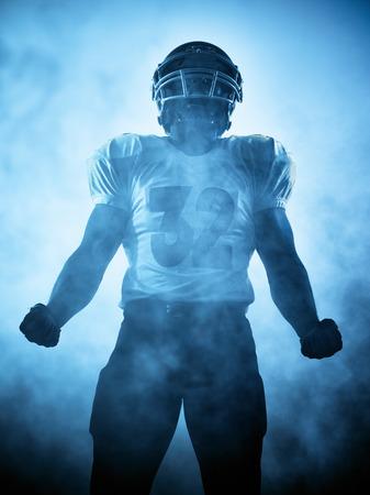 een American football-speler portret in silhouet schaduw op witte achtergrond
