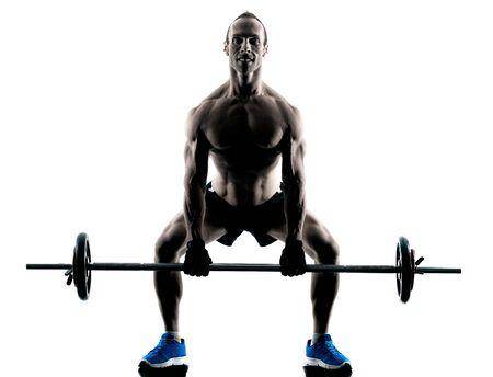 athletic body: one caucasian man exercising fitness body building exercises in studio in silhouette isolated
