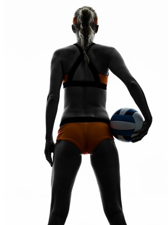 beach volley: one woman beach volley ball player silhouette in studio silhouette isolated on white background