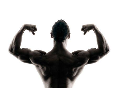 cuerpo hombre: ejercicios del edificio del cuerpo de fitness ejercicio de un hombre caucásico en el estudio de la silueta aislado