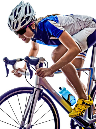 'cycles: woman triathlon athlete  cyclist cycling on white background