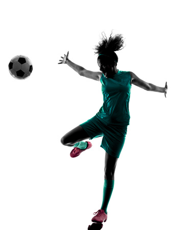 one teenager: one teenager girl child  playing soccer player in silhouette isolated on white background Stock Photo