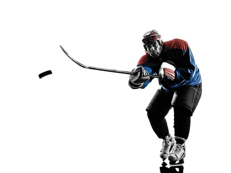 blading: one caucasian man ice hockey player  in studio  silhouette isolated on white background Stock Photo