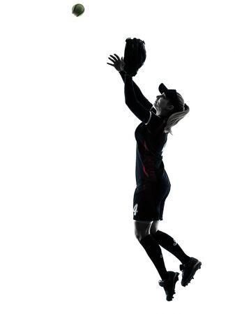 siluetas mujeres: una mujer jugadores de softbol de juego en silueta aislados sobre fondo blanco Foto de archivo
