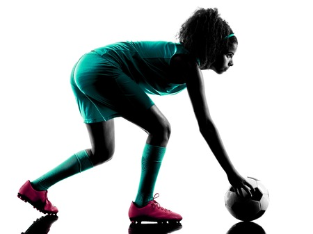 teen silhouette: one teenager girl child  playing soccer player in silhouette isolated on white background Stock Photo