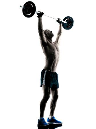 hombres haciendo ejercicio: ejercicios del edificio del cuerpo de fitness ejercicio de un hombre caucásico en el estudio de la silueta aislado
