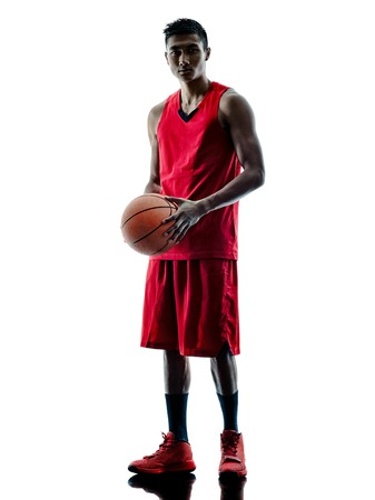 one: one caucasian man basketball player isolated in silhouette white background Stock Photo