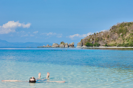 sun bathing: woman tourist sun bathing swimming in Palawan Philippines