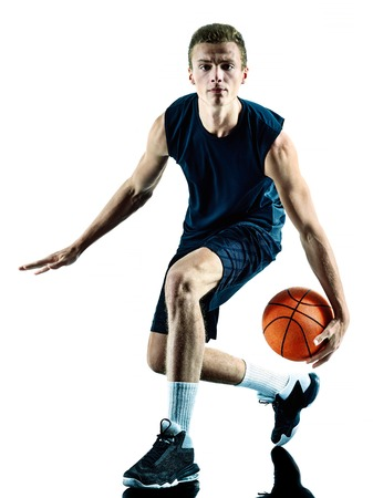 isolated man: one caucasian man basketball player isolated in silhouette white background Stock Photo