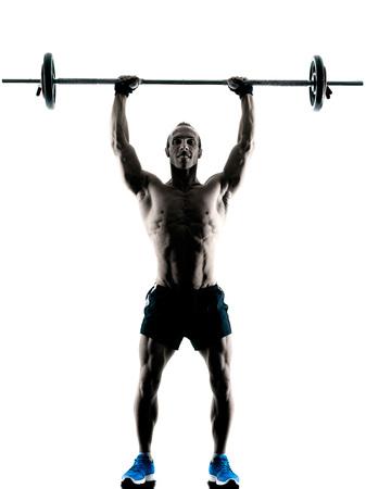 cuerpo hombre: ejercicios del edificio del cuerpo de fitness ejercicio de un hombre cauc�sico en el estudio de la silueta aislado