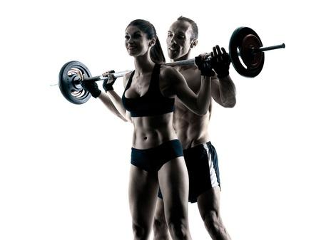 silueta hombre: Una pareja caucásica ejercicios del edificio del cuerpo de fitness ejercicio en el estudio de la silueta aislado