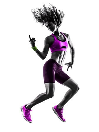 jump: one caucasian woman exercising  fitness jumping in studio silhouette isolated on white background Stock Photo