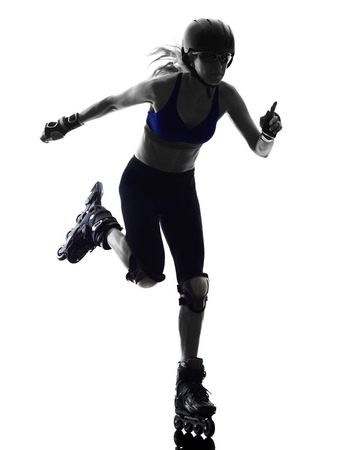 blading: one  woman in roller skates silhouette studio isolated on white background Stock Photo
