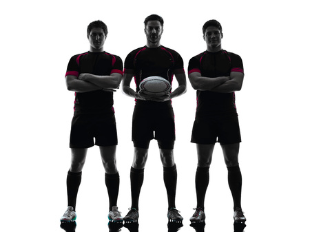 teammates: one caucasian rugby  men players  in studio  silhouette isolated on white background Stock Photo
