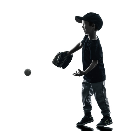 softball player: child playing softball players in silhouette isolated on white background