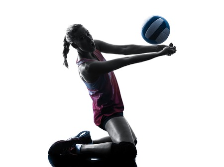 one caucasian woman volleyball in studio silhouette isolated on white background